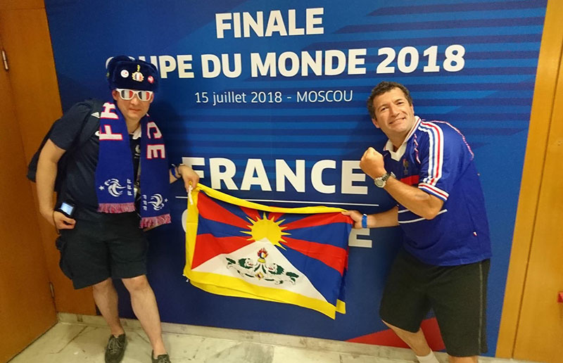 Team Tibet Jersey raising Tibet T-shirts and the national flag of Tibet with French Flag at St. Petersburg Stadium in Russia during the FIFA World Cup Moscow, 10 July 2018. Photo: Team Tibet Jersey
