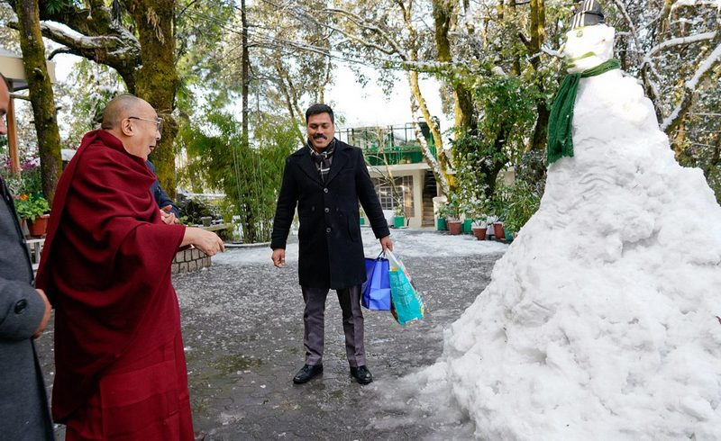 His Holiness the Dalai Lama pleased to see a snowman in the driveway of his residence in Dharamsala, HP, India on February 8, 2019. Photo by Ven Tenzin Jamphel