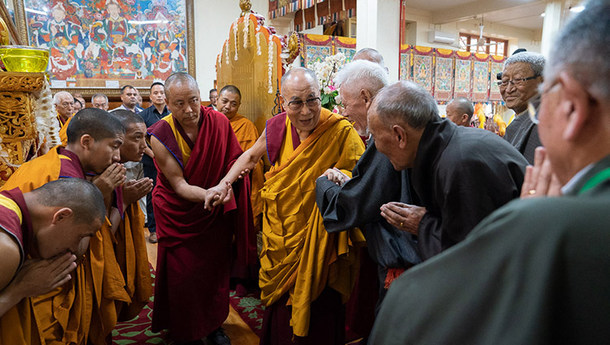 His Holiness the Dalai Lama greeting retired CTA officials as he arrives inside the Main Tibetan Temple in Dharamsala, HP, India on July 5, 2019. Photo by Tenzin Choejor