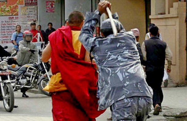 A Nepalese policeman torturing a Tibetan monk during a peaceful protest in Nepal, many say that Nepal is just a puppet of the PRC. Photo: File