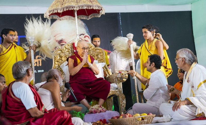 A member of the Sri Udasin Karshni Ashram offering a lamp to His Holiness the Dalai Lama during a Fire Puja at the Ashram in Mathura, UP, India on September 22, 2019. Photo by Tenzin Choejor