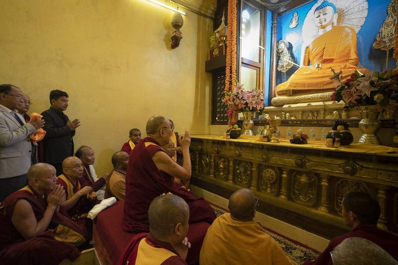 His Holiness the Dalai Lama paying his respects to the Buddha statue inside the Mahabodhi Temple in Bodhgaya, Bihar, India on January 2, 2019. Photo by Tenzin Choejor