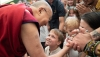 His Holiness the Dalai Lama greeting younger members of the audiences from around the world at the main Tibetan temple in Dharamsala, HP, India on May 19, 2018. Photo: Tenzin Choejor