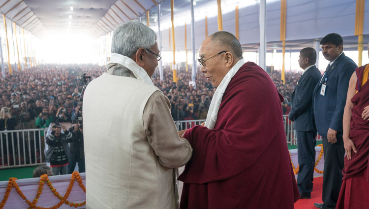 His Holiness the Dalai Lama and Bihar Chief Minister Nitish Kumar exchanging greetings at the start of the book release ceremony in Bodhgaya on January 7, 2018. Photo: OHHDL