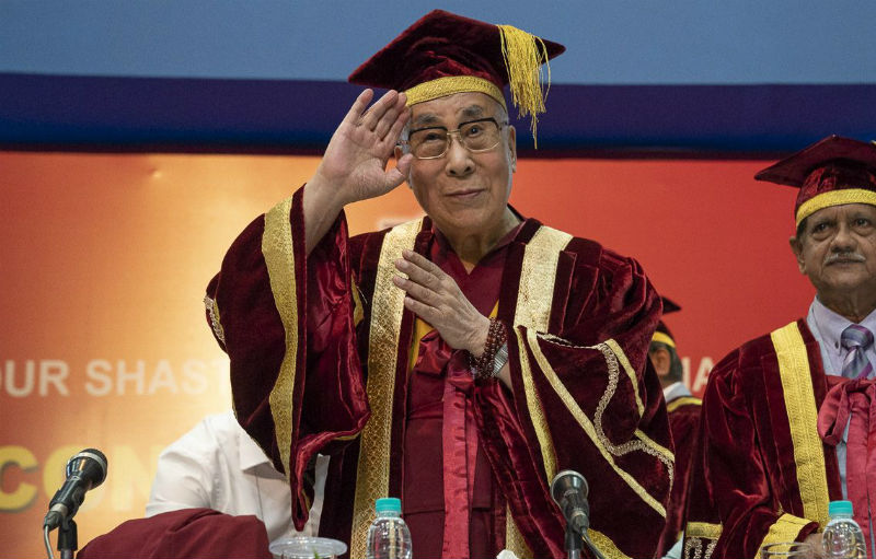 His Holiness the Dalai Lama waving to the audience as he takes his seat at the dias at the start of the Lal Bahadur Shastri Institute of Management Convocation in Delhi, India on April 23, 2018. Photo by Tenzin Choejor