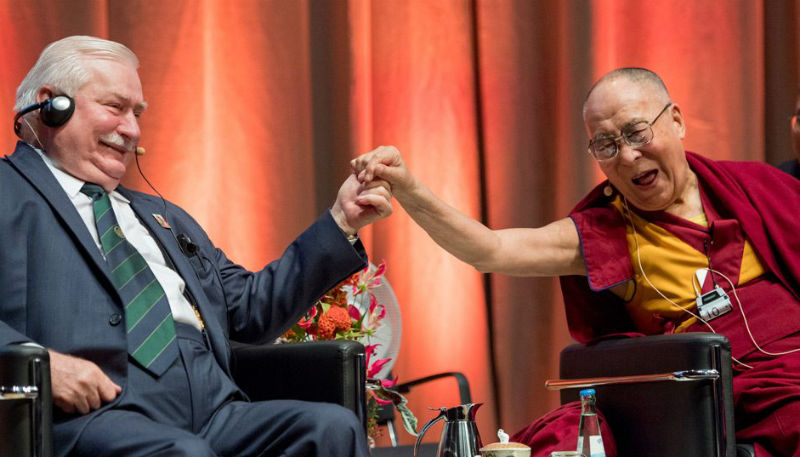 His Holiness the Dala Lama with Lech Walesa, Fellow Nobel Peace Prize Laureate and former President of Poland, during the discussion on non-violence in Darmstadt, Germany on September 19, 2018.  Photo: Manuel Bauer