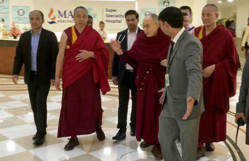 His Holiness the Dalai Lama making his way out from the Max hospital after successfully recovering from a chest infection. Photo: OHHDL