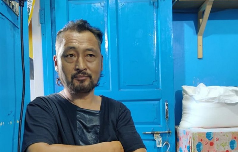 Tenzin Chodup, a former the Special Frontier Force (SFF), at his Rewa Cafe in Dharamshala, India. Photo: TPI/Anisha Joneja