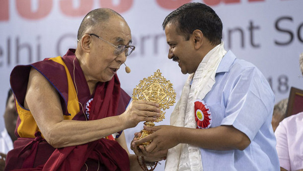 His Holiness the Dalai Lama presenting Delhi Chief Minister Arvind Kejriwal with an auspicious emblem in New Delhi, India on July 2, 2018. Photo by Tenzin Choejor